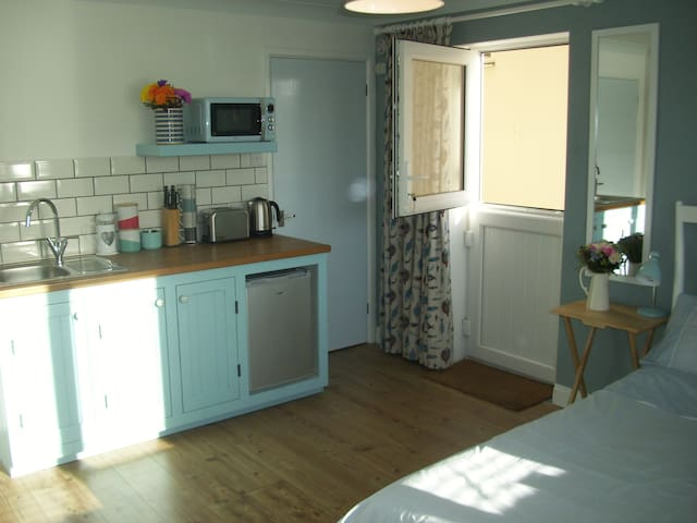 Lyme Regis cosy studio for two with parking