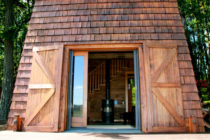 View into the living room - cabin is made of mainly recycled cedar wood.