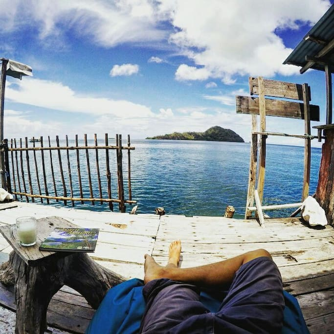 Relax on our terrace. Jump directly into the ocean or just enjoy the view on Tumbak Island .