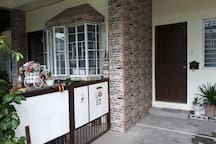 Separate entrance. The airbnb unit is at the right side (no gate). The door at the left side is our entrance (gated).