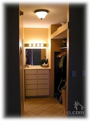 Closet and vanity outside of bathroom.