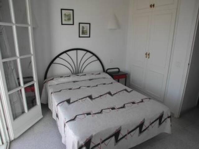 Bedroom with doors to terrace