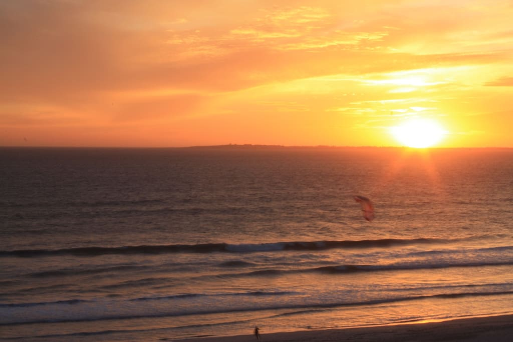 View from balcony: Sun setting over Robben Island