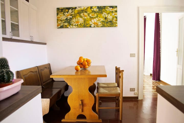 Simple and Bright Diningroom with Kitchen and Table for 4 persons