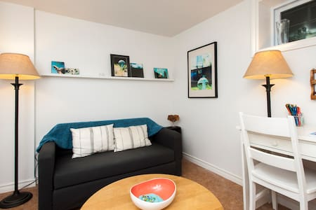 This stylish basement apartment comfortably accommodates two and is nearby lots of amenities to ensure a hassle-free stay. Enjoy a full size bed plus pull-out sofa, and plenty of fun details like magnetic poetry and complimentary postcards.