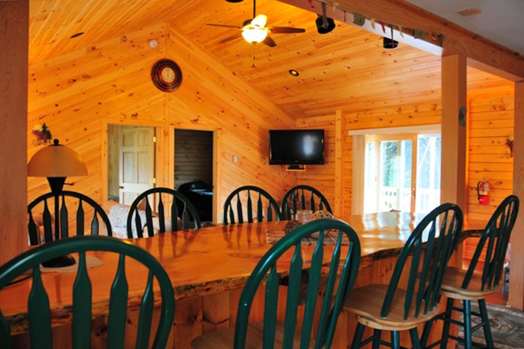 Spacious family room with beautiful wooden dinning table