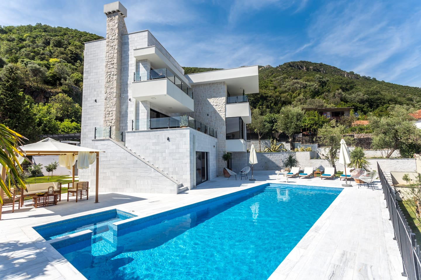 Stunning modern architecture of Villa White Olive accentuates beautiful natural surroundings alongside luxury amenities.  Here you will enjoy swimming pool, sauna and a rooftop terrace with a sea view.  Sounds like a perfect vacation!