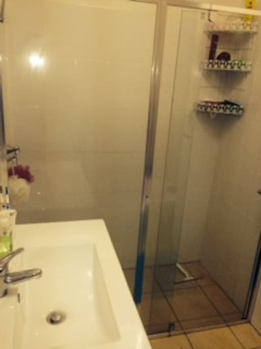 Double shower along with a bath. The toilet is separate to the bathroom which is handy.