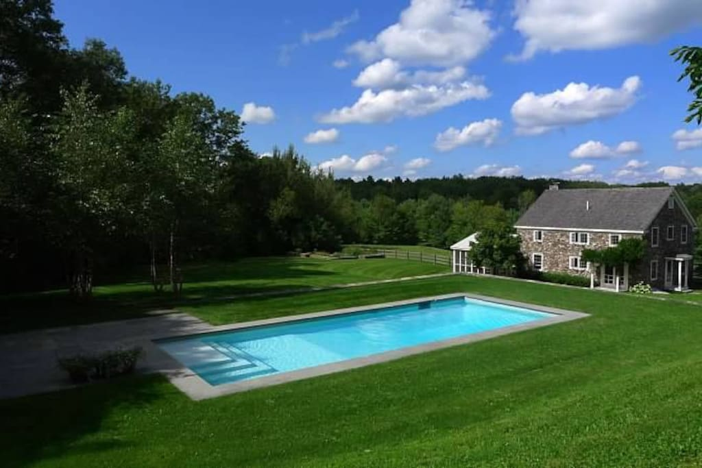 View of pool area and house