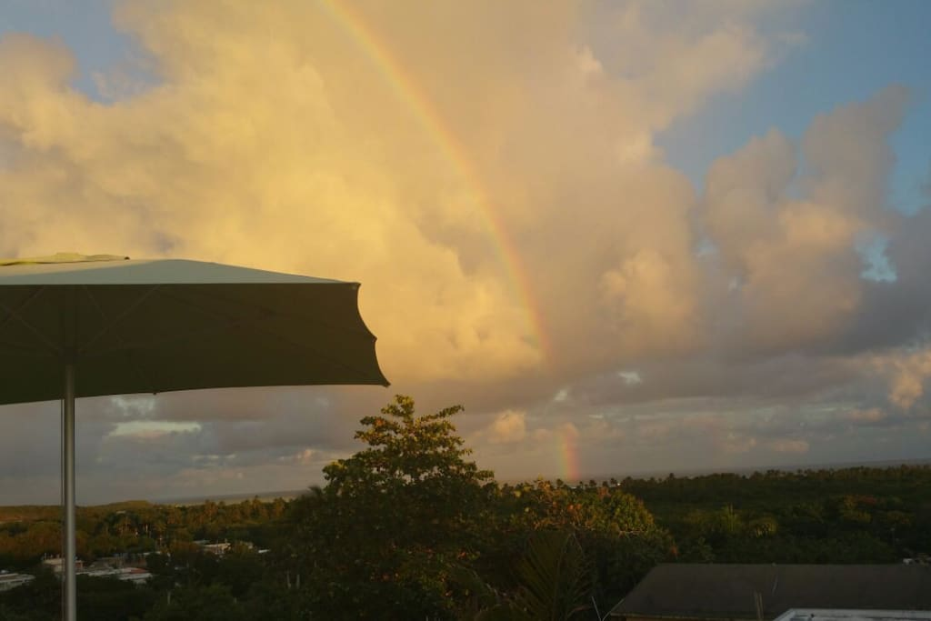 beautiful rainbow seen from rooftop