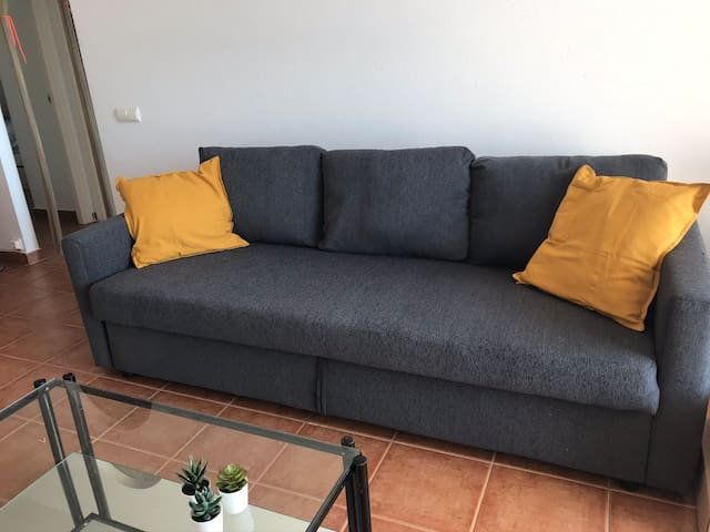 Nice modern couch which can be used as a bed as well.