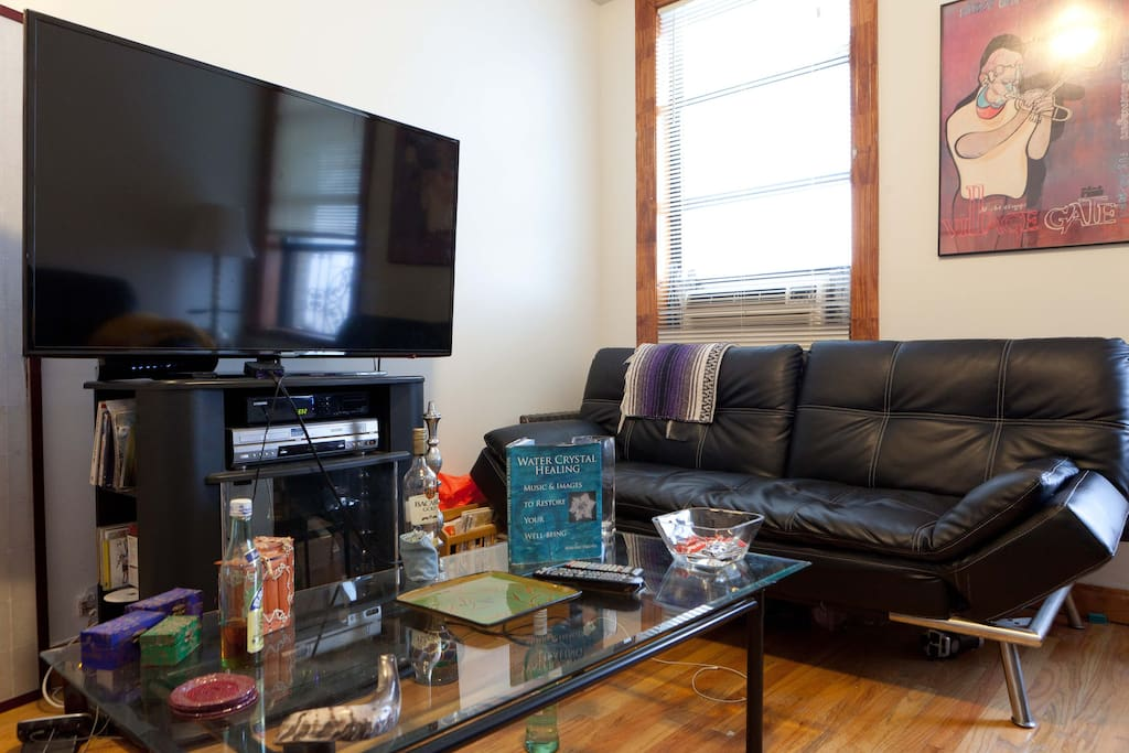 Cozy living room, overlooking a long stretch of park. 55 inch television.