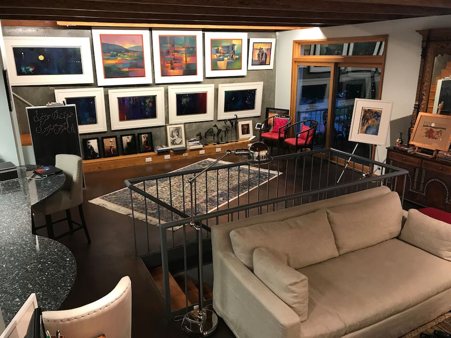 Second gallery wall. The artwork changes constantly as pieces are sold and new works arrive.
