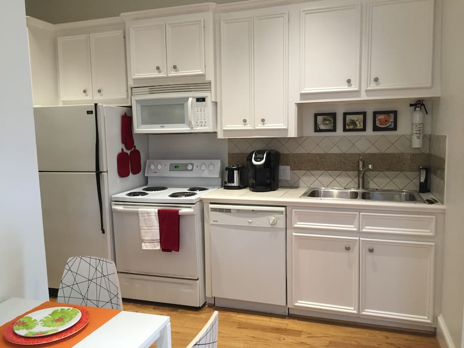 Fully stocked kitchen with Keurig coffee maker.