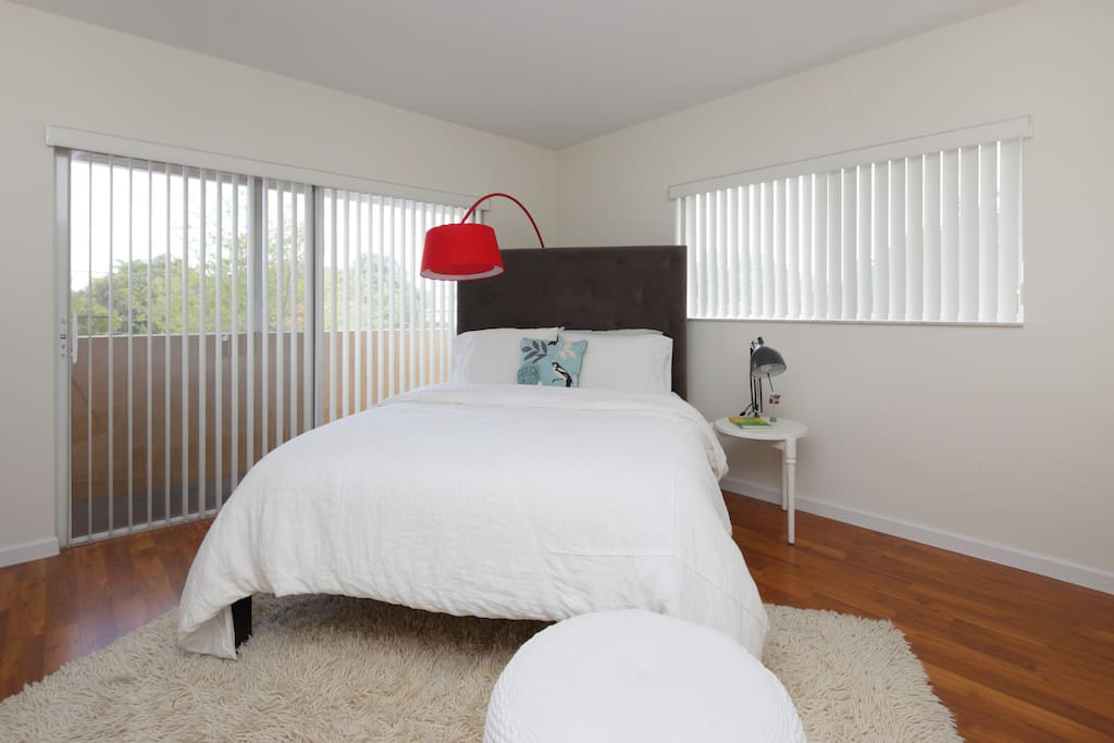 2nd bedroom. Queen bed, roomy and relaxing bedroom. Get views of the Grove from balcony