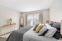 Master bedroom with king size bed, double wardrobe, hangers and extra blankets