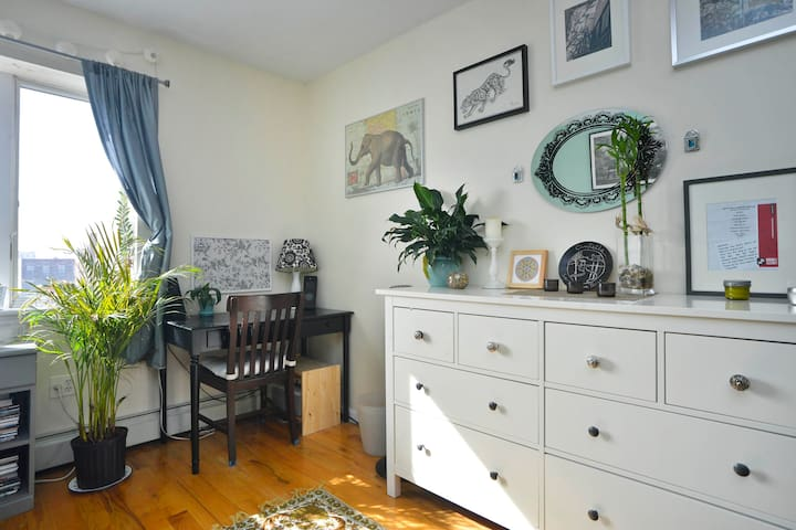 Desk and chest of drawers in the bedroom.