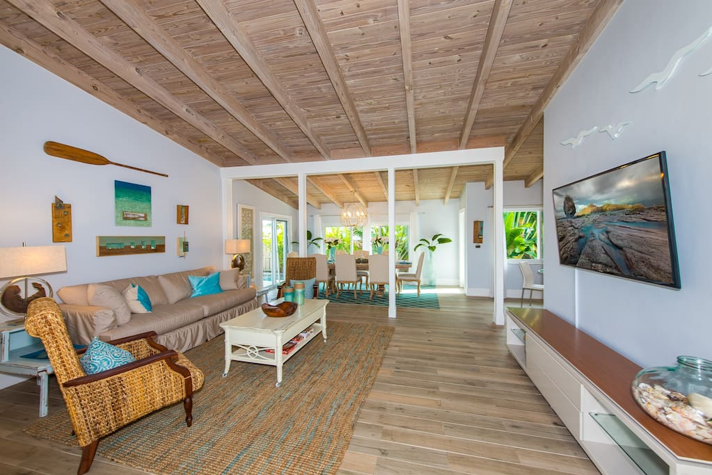 Vaulted ceilings and ceramic driftwood tile flow throughout