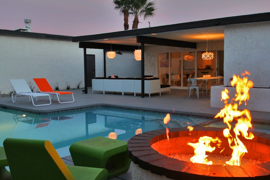 A raised built-in firepit right next to the hot tub.