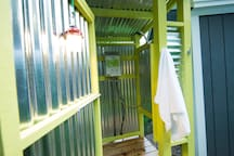 Hip & Modern Outdoor Shower with Cedar Decking and Unlimited Hot Water