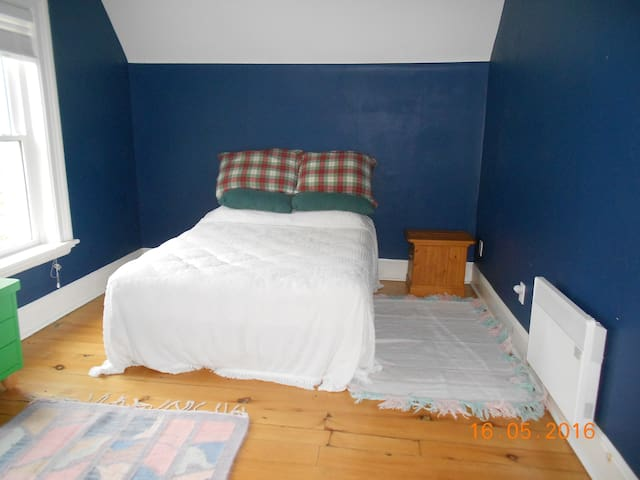 Same bedroom  which also has a double bed and a large closet.