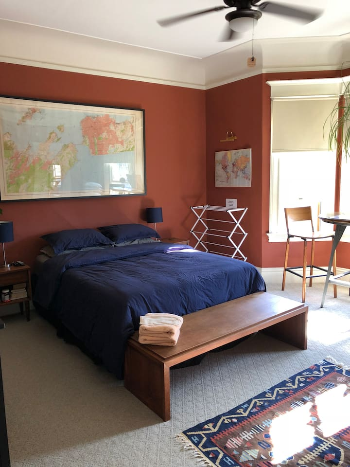 Large room with queen bed and TV with Netflix.