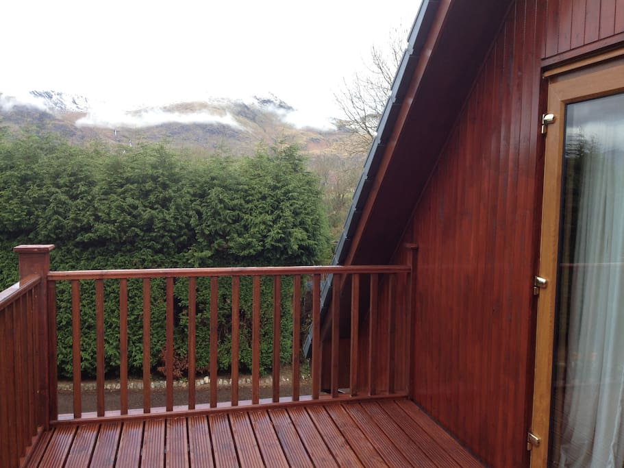 Large balcony overlooking loch.