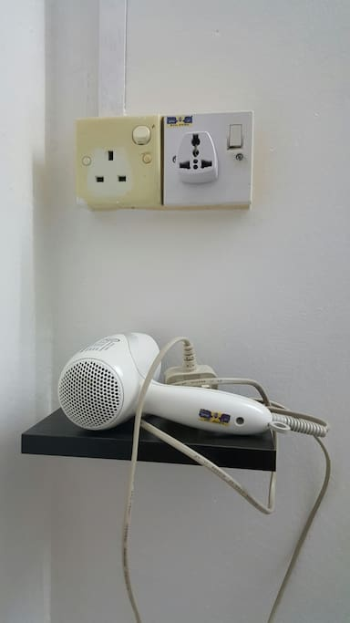 phone charging area, hair dryer, and international plug are provided in room.