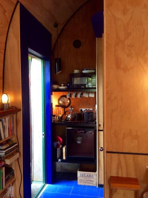 Microwave, kettle, toaster, fridge, crockery and cutlery.....