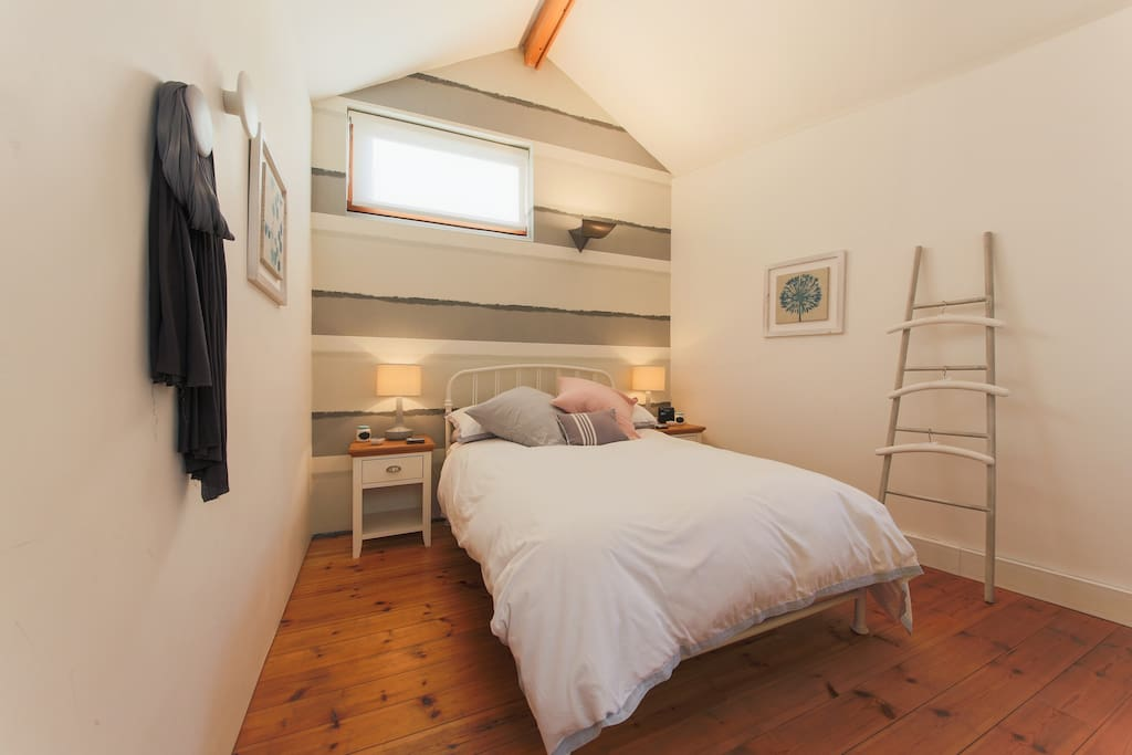Bedroom one, with lovely Scandinavian dots we picked up in Stockholm on the wall that you can hang clothes on