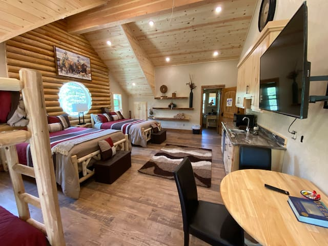 Lovely, new, spacious private suite with vaulted ceilings, beautiful forest view, four queen beds, kitchenette, large screen smart TV, dining table, private bathroom with large soaker tub and deluxe shower.