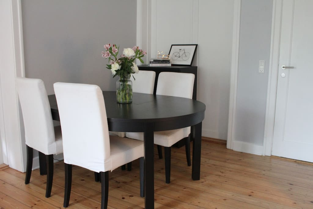 The dining table. There are four main chairs, but there is a possibility for seating more people if needed.