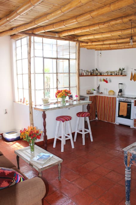 Cooking Time! Colorful kitchen with lovely view to a colonial church.