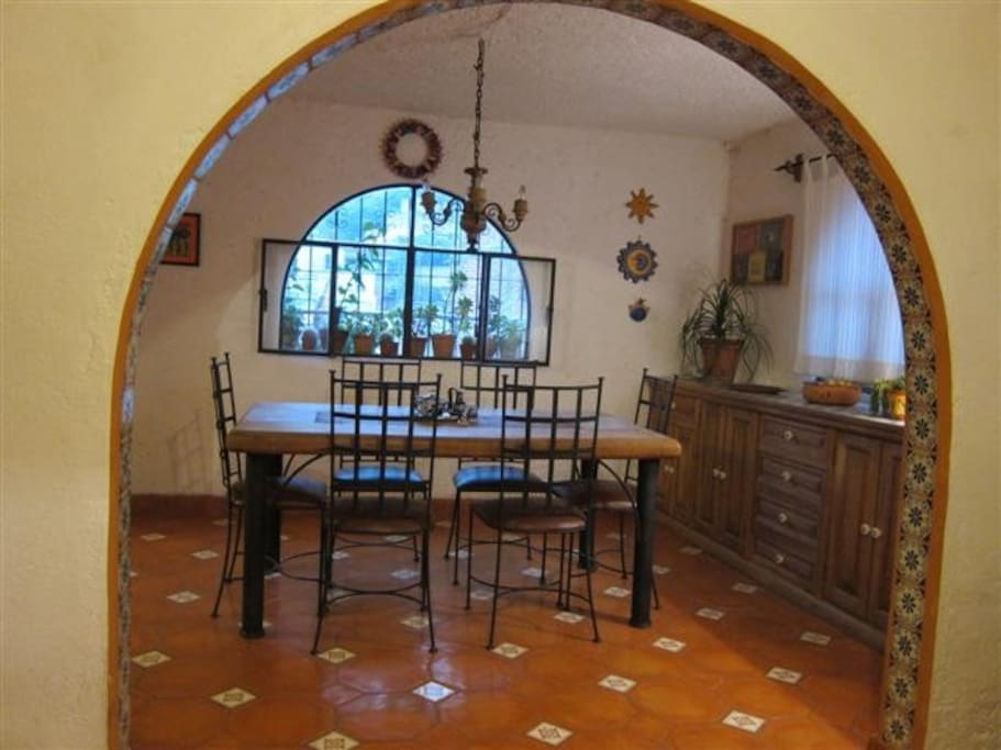 Dining room framed by colorful tiled arches and floors