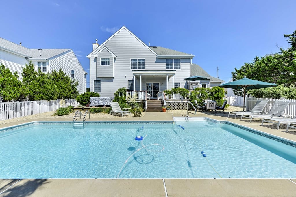 A large, private heated pool in the back yard includes ample seating for soaking up the sun.