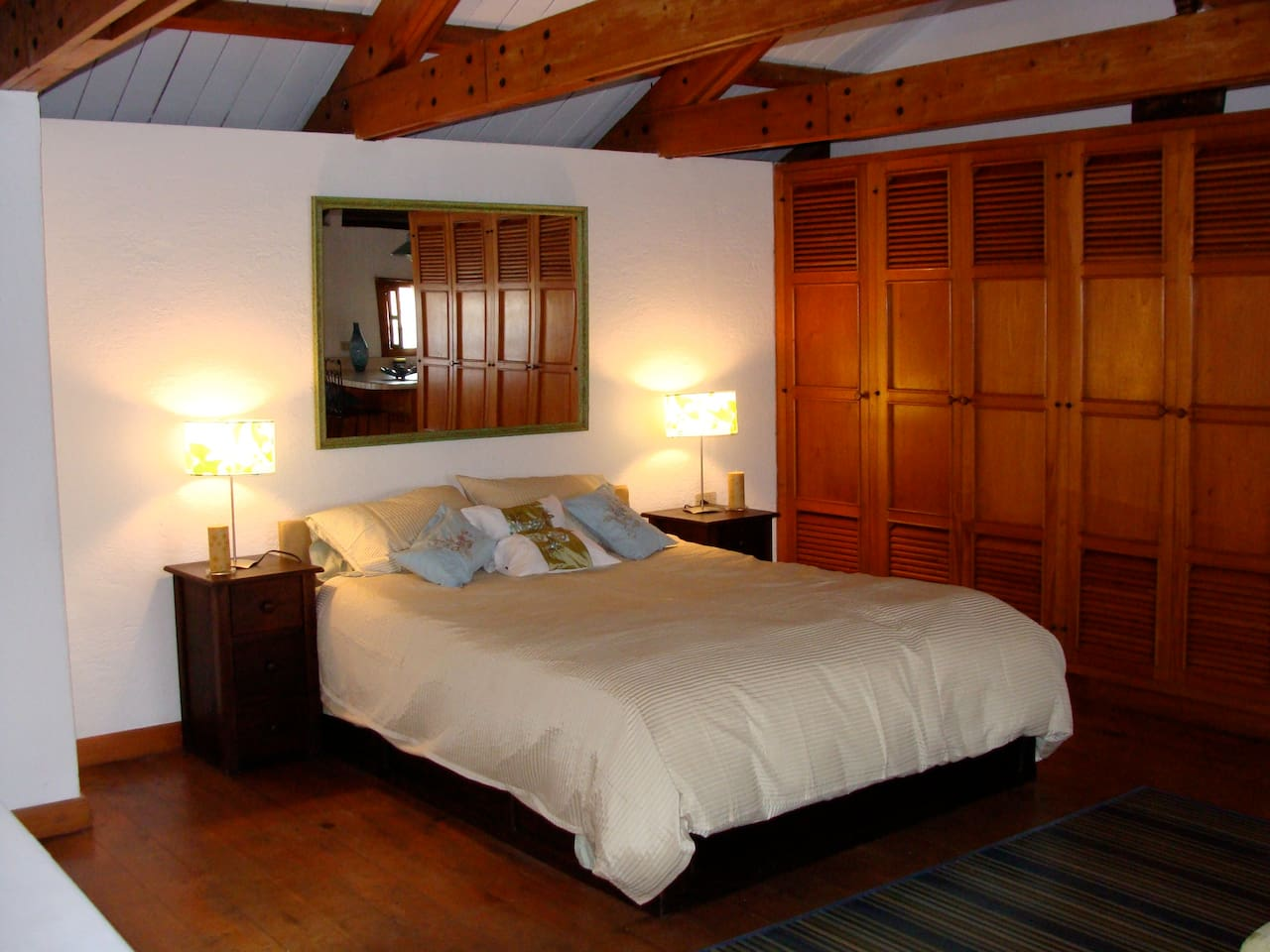 Large bedroom area with queen bed, luxury bedding