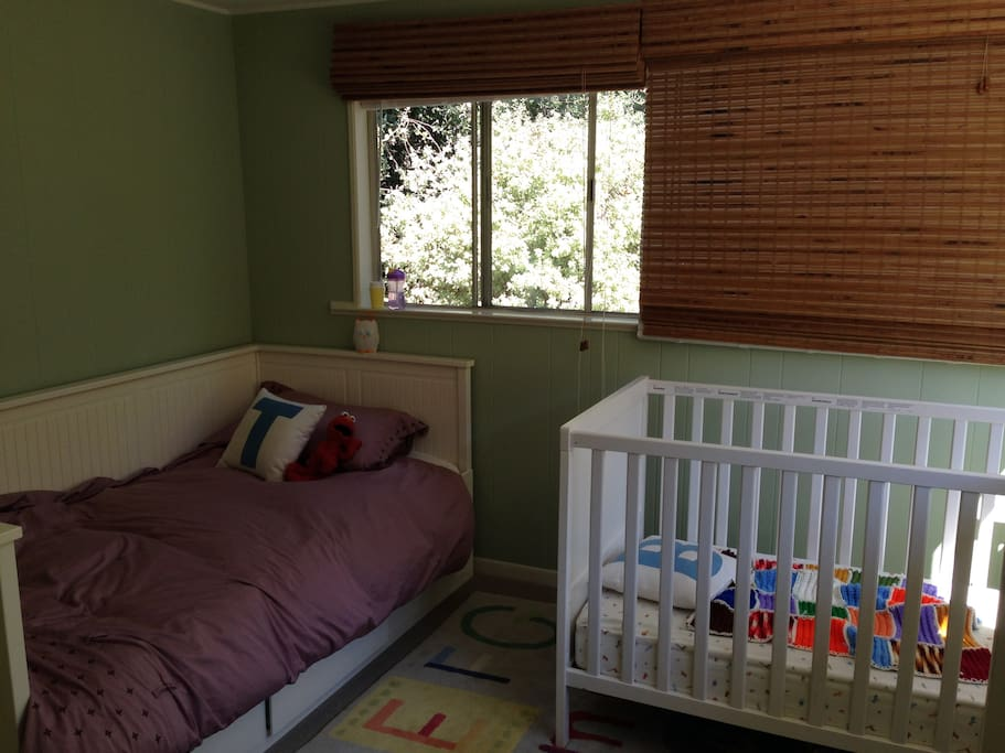 Second bedroom, with twin bed and crib