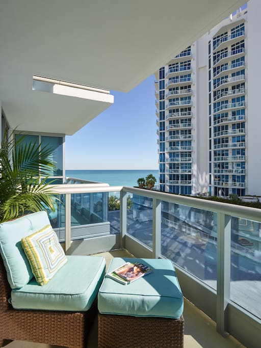 Private balcony with comfortable seating and views of the ocean, the bay and downtown Miami
