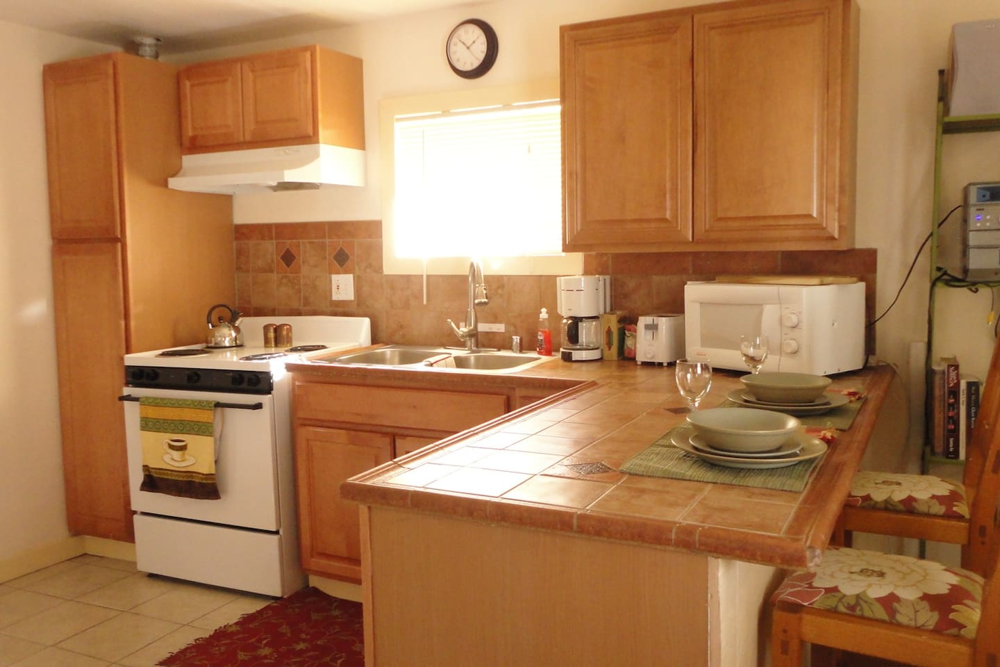 Full sized kitchen with bar for dining.