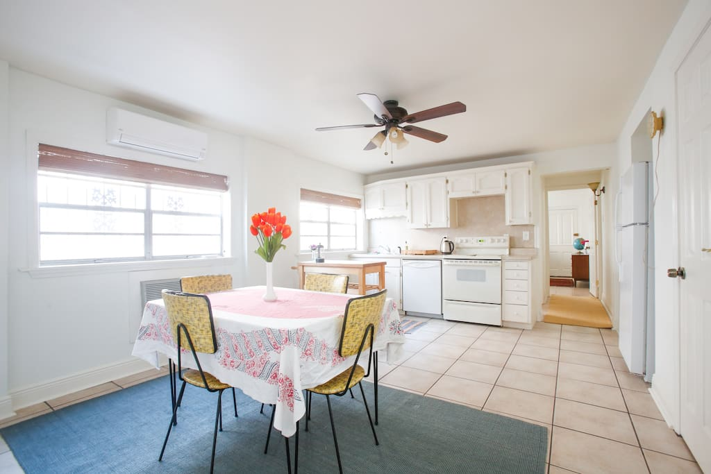 The second room is a spacious kitchen and dining room. There is a full stove, fridge-freezer, dishwasher and pantry.