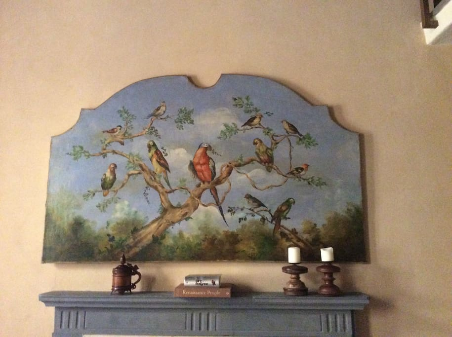 The oil painting over the mantle comes from a XVII Century manor house in Tuscany....