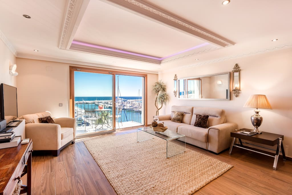 Nice living and dining room with plush sofa and great views in Puerto Banus, Marbella