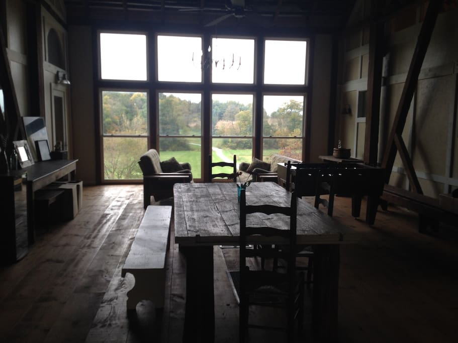 Large center room with large windows overlooking field and Beaver Creek which runs through the property.