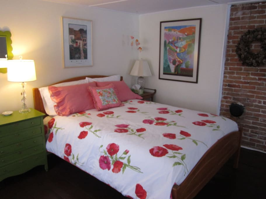 New queen sized bed with crisp percale linens.