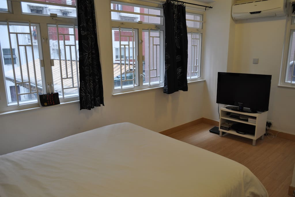 Large bedroom with big screen TV with a DVD player. Local Channels and  HBO