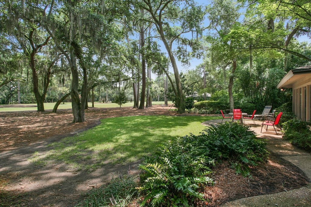 Back of home with spacious patio and plenty of seating with view of 8th Hole Harbour Town Golf Course