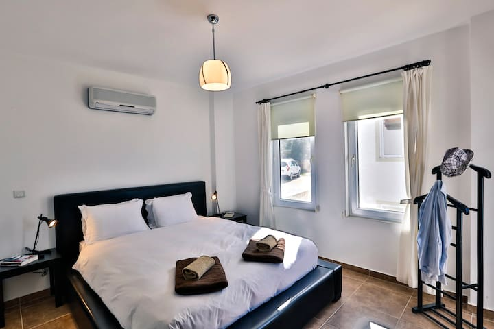 Master double bedroom with private balcony and en suite shower room.