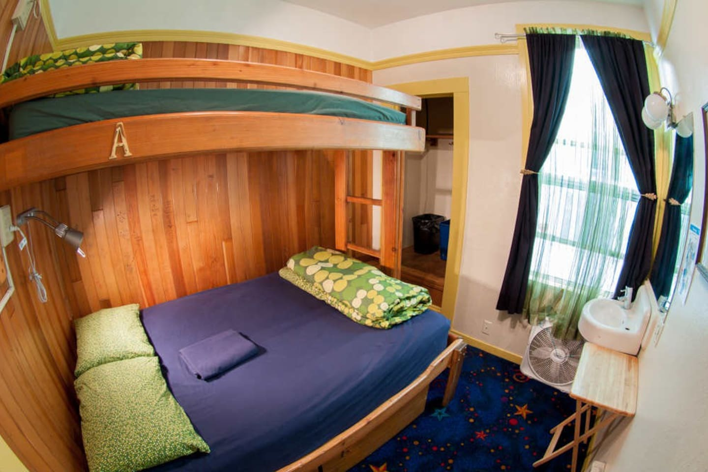 The room has one bunk bed with a double bed on the bottom and a single bed on top