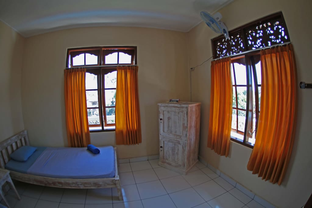 Private twin bed room with sharing shower/toilet. We have fan and private locker for your comfortable stay.