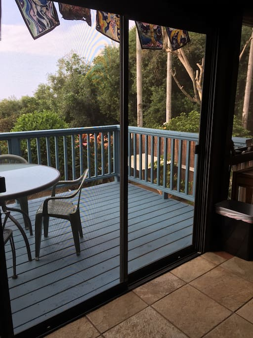Step out to the outdoor lanai. Great place for enjoying a meal, playing cards or just taking in the views.